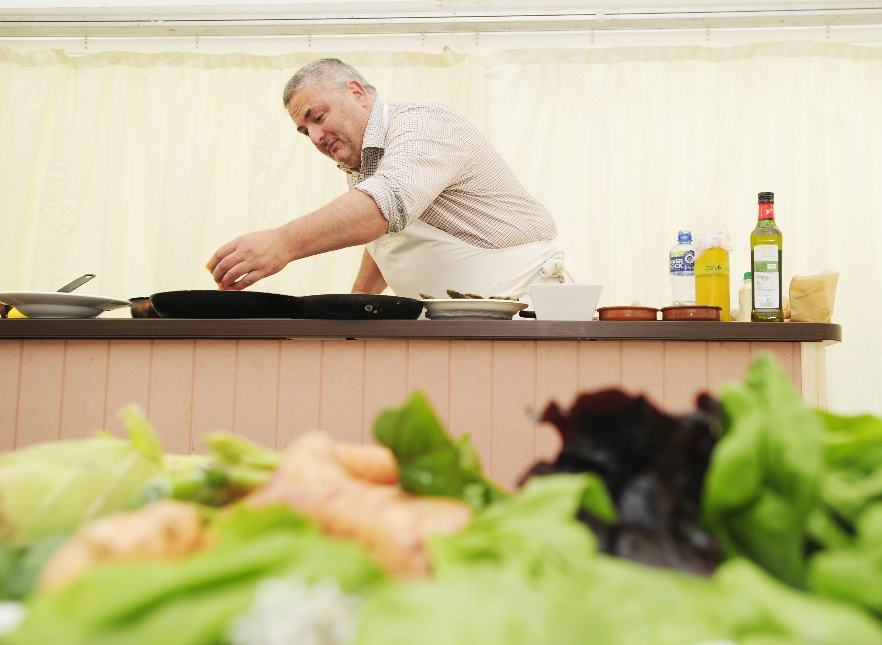Richard Corrigan, a world renowned chef, busy creating in the demo kitchen