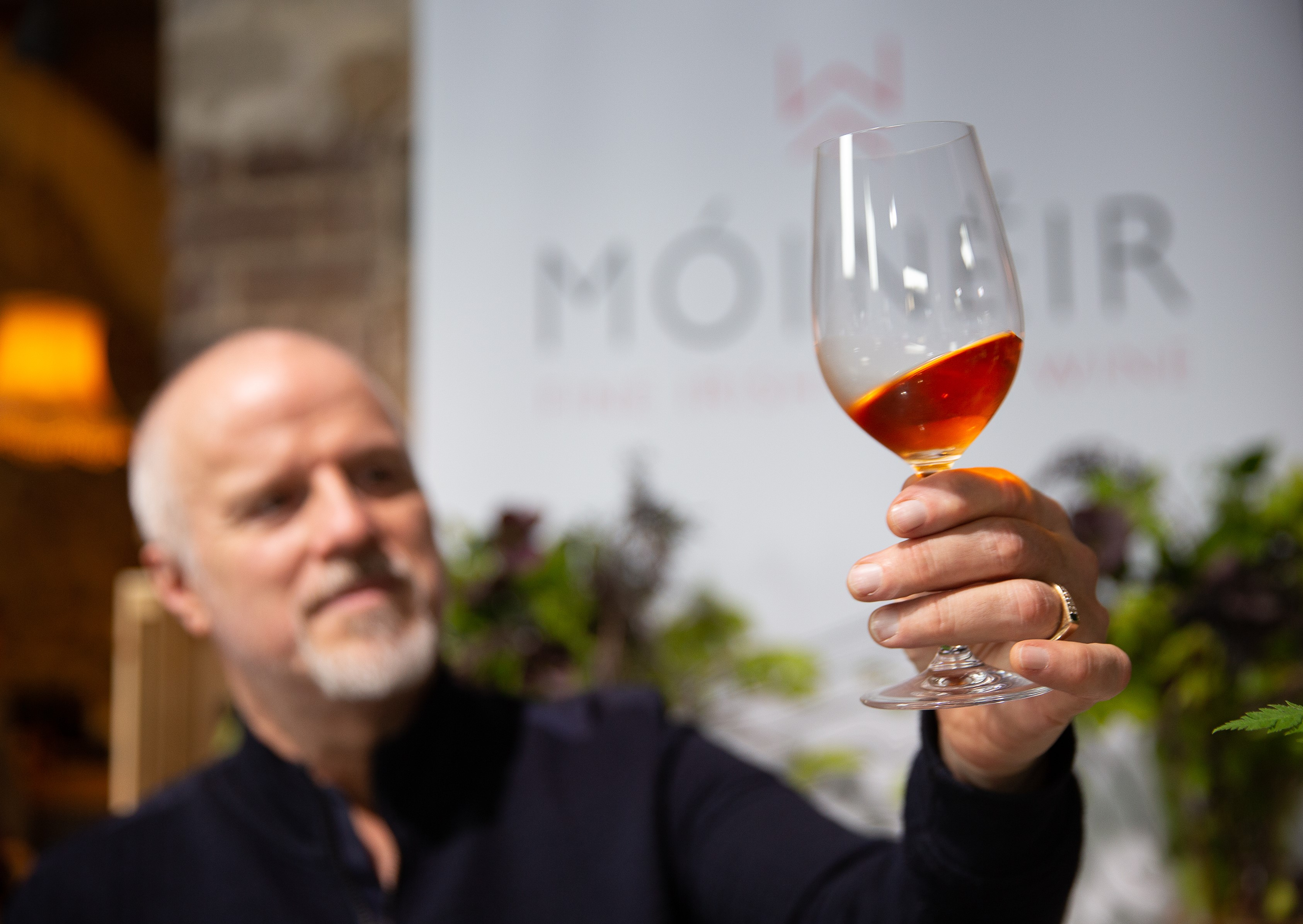 Brett, the winemaker, observing the beautiful colour of his Móinéir Irish Strawberry Wine, made from wonderfully aromatic, locally grown strawberries