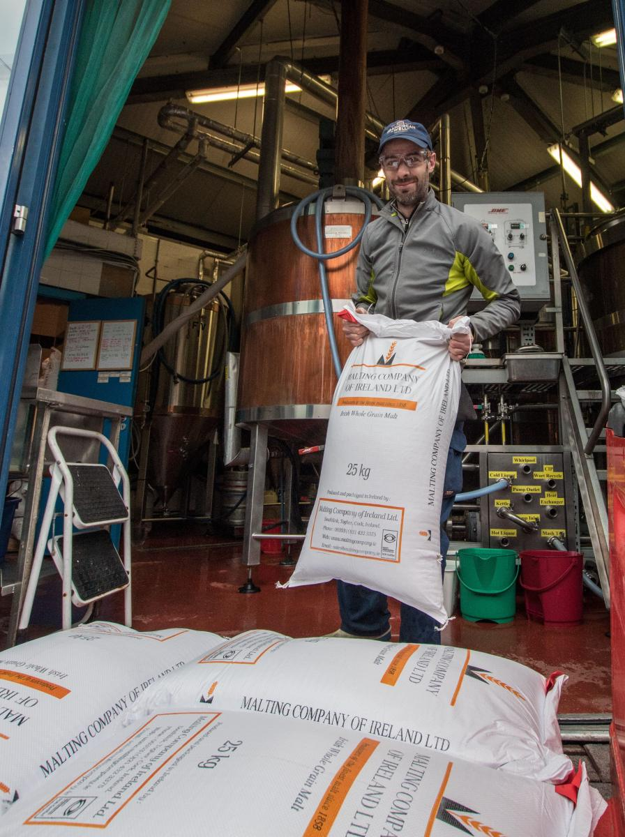 Tom, one of our brewers bring in the malt.
