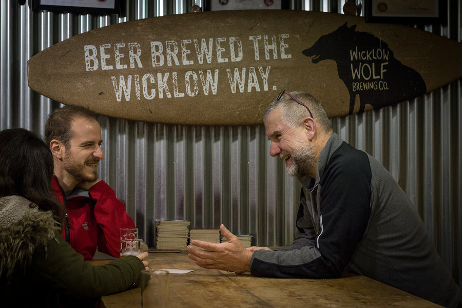 Quincey, the owner and cofounder of Wicklow Wolf Brewery enjoying good chat and banter with guests who've dropped in for a tour and tasting of his unique craft beers, brewed using locally grown hops