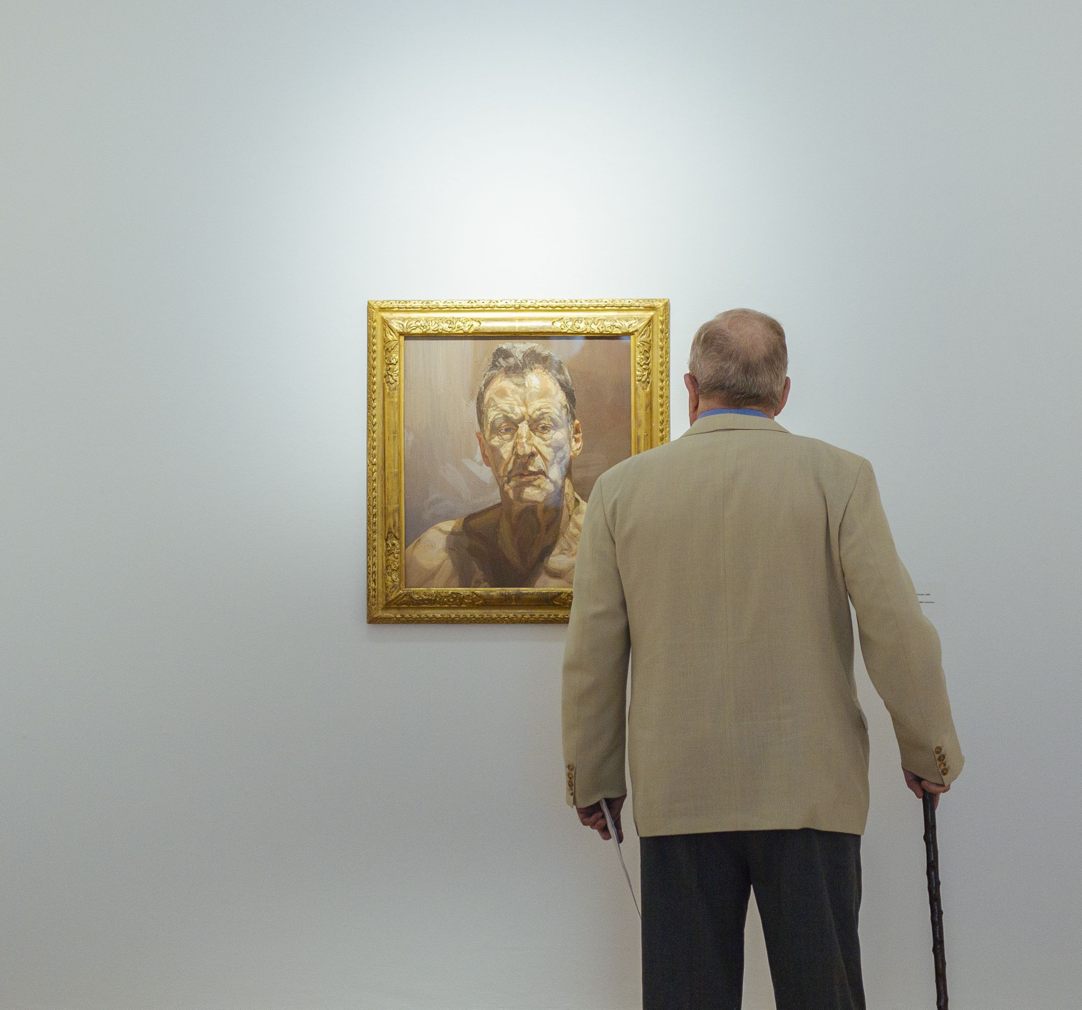 Visitor viewing the work by Lucian Freud, Reflection (Self-Portrait), 1985, Oil on canvas, 55.9 x 53.3cm, Private Collection, IMMA Collection: Freud Project. © The Lucian Freud Archive / Bridgeman Images. Photo Kyle Tunney